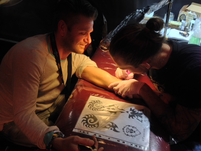 Blizzard's Marc Olbertz getting tattooed at DreamHack Stockholm